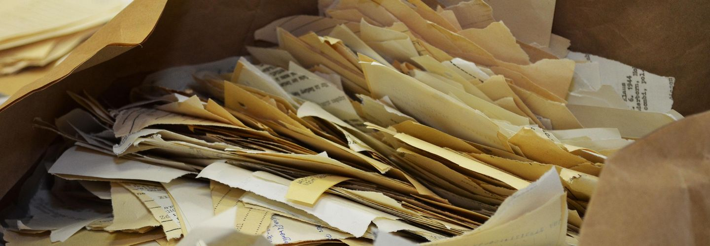 Hand-torn documents in the Stasi Records Archive.