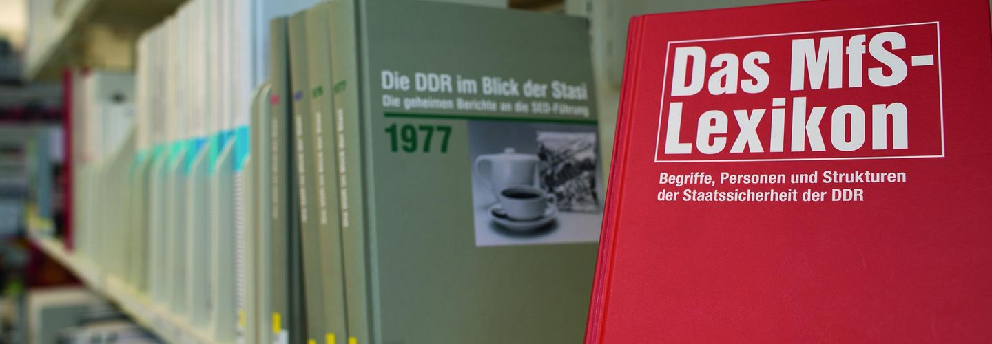 The Stasi Records Agency publishes several publications a year. A shelve in a library with several books.