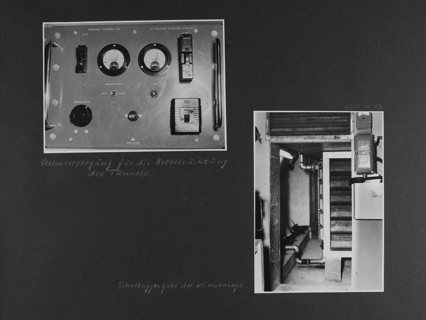 [Bild 1: Nahansicht eines elektronischen Gerätes. Zu sehen sind zwei Messuhren sowie ein Regler und weitere Knöpfe. Sie alle sind in Englischer Sprache beschriftet.] [handschriftliche Ergänzung: Stromversorgung für die Notbeleuchtung des Tunnels.]  [Bild 2: Durch den Durchgang mit darüber liegendem Lüftungsgitter hindurch wird in den dahinter liegenden Raum fotografiert. Es handelt sich um einen verwinkelten Raum, in dem ein Rohrsystem zu sehen ist. Es ist an ein großes undefinierbares Gerät angeschlossen.] [handschriftliche Ergänzung: Schaltaggregate der Klimaanlage]